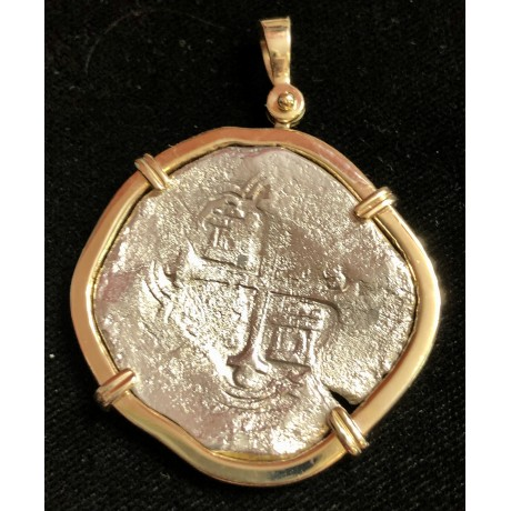Atocha grade two 8 Reale from Mexico with a very heavy 14Kt. Gold Bezel. coin#CH4-82-36417