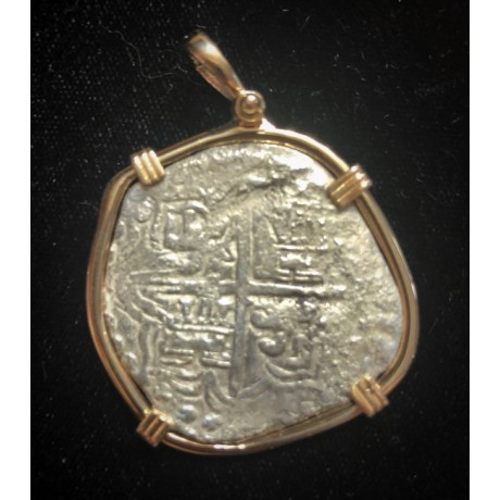 ATOCHA grade 2, 8 reale, 26 1/2 g. Scarce cross reversals. 14 karat gold bezel with a boat shackle at the top, coin # 85A-209345